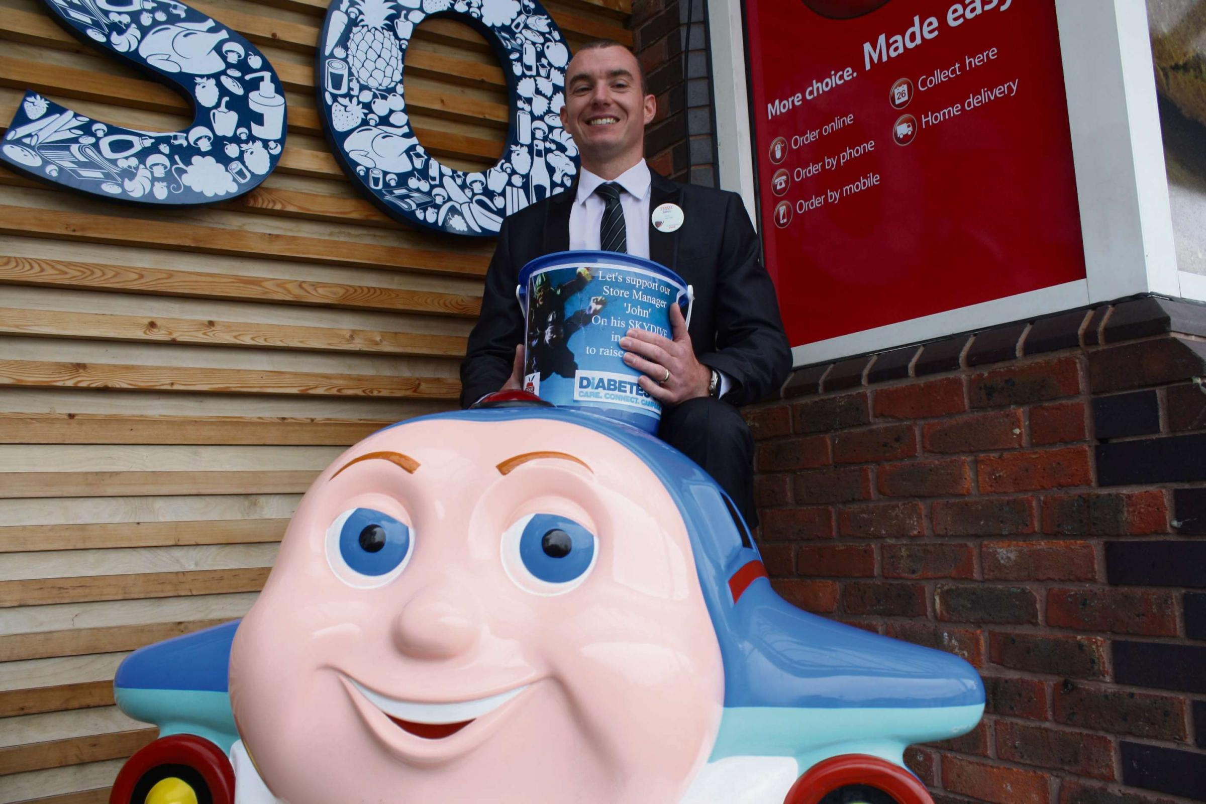 High flying store manager gives charity a lift