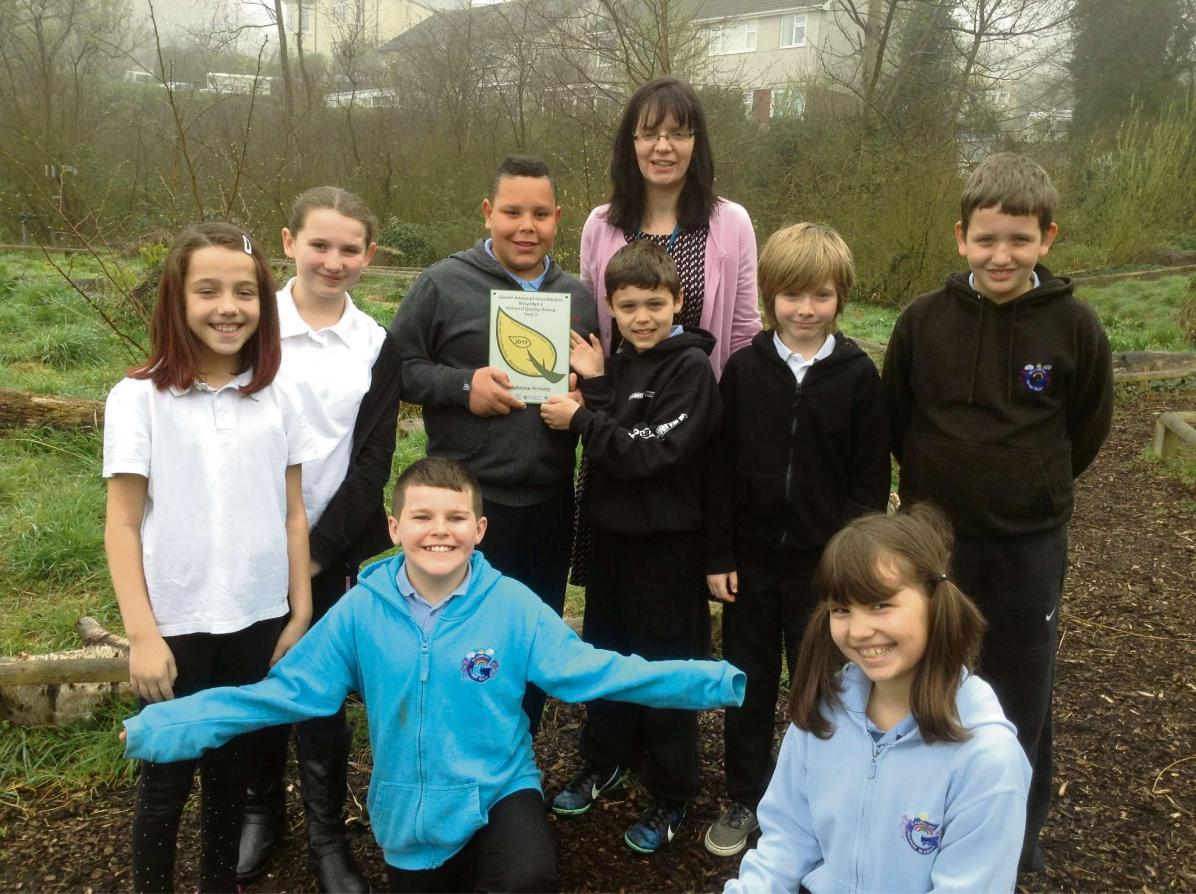 AWARD: Catherine Perry from Public Health Wales with pupils from Gladstone Primary