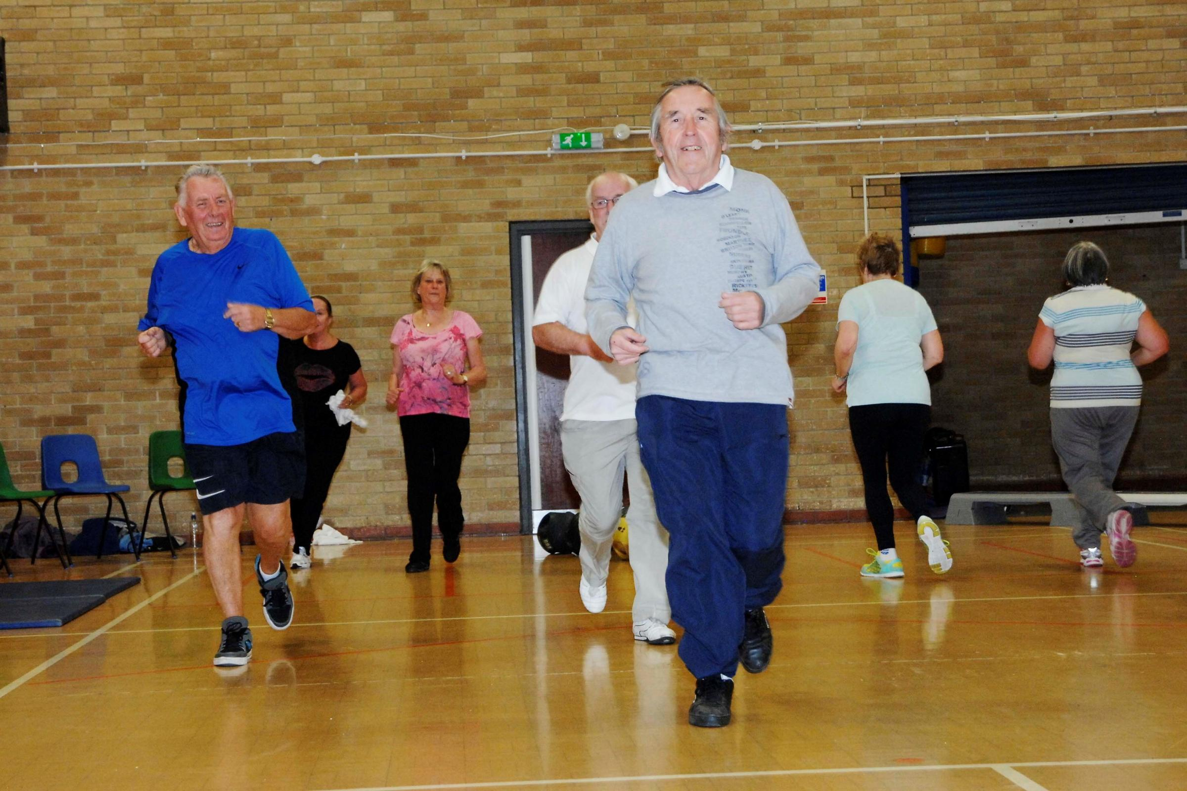 WORKOUT: Cllr Gwyn John gets a workout along with members of the GP referral scheme at Barry Leisure Centre. (7172638)