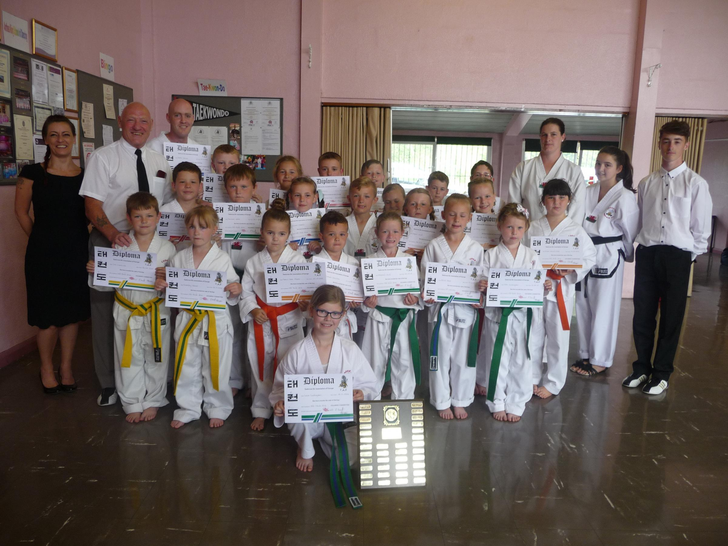 Pictured with their instructors and grading examiners' are the successful candidates