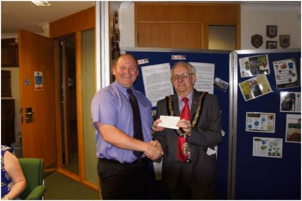 PRESENTATION: David Morris head teacher of Jenner Park Primary receives a cheque as part of Barry Town Council's Books for Schools Scheme from the Mayor of Barry Councillor Jeff Evans.