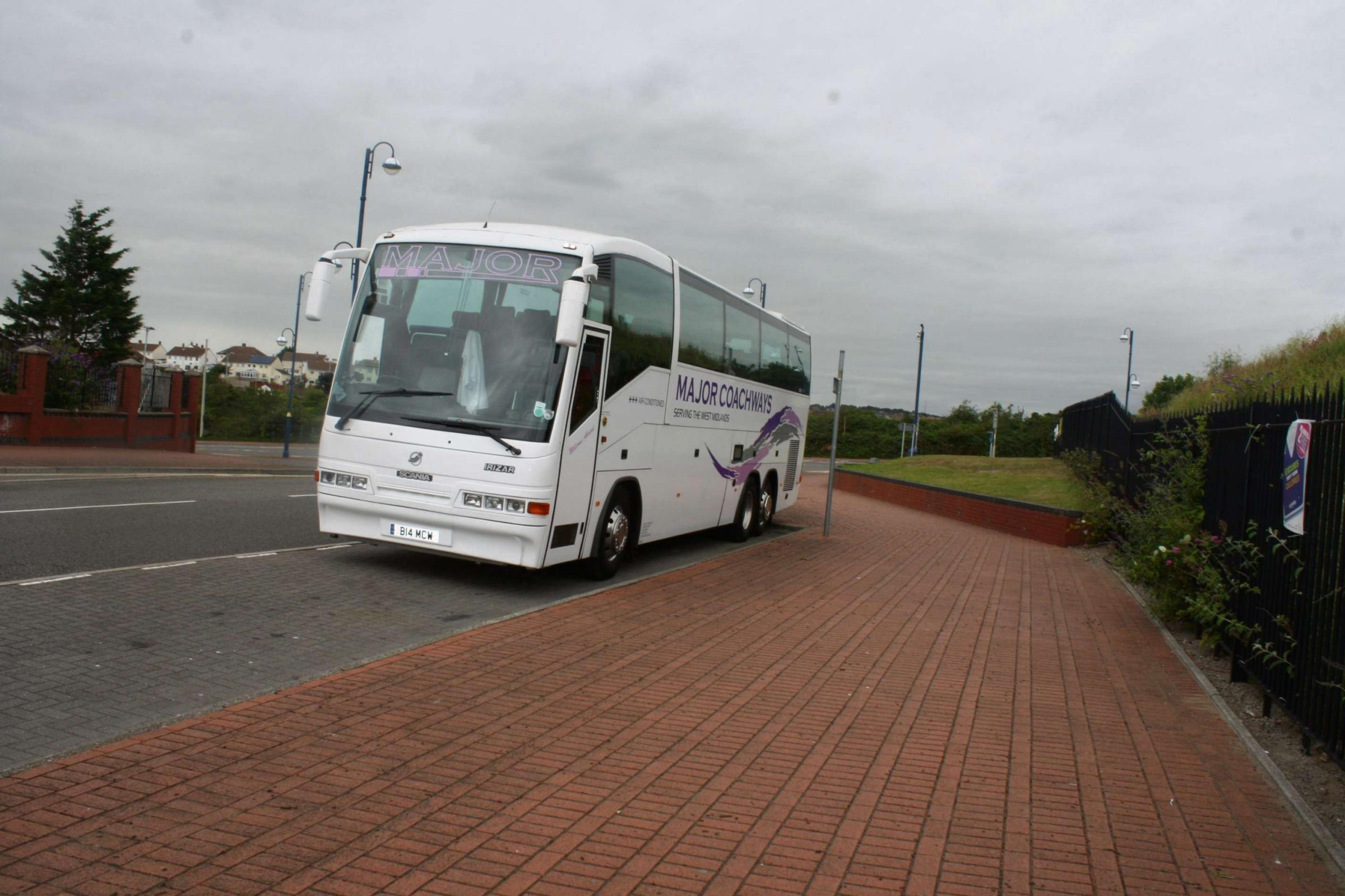 PARKING: A coach stops in the layby adjacent to the Nell's Point carpark with the driver asleep in the front passenger seat   (7973264)