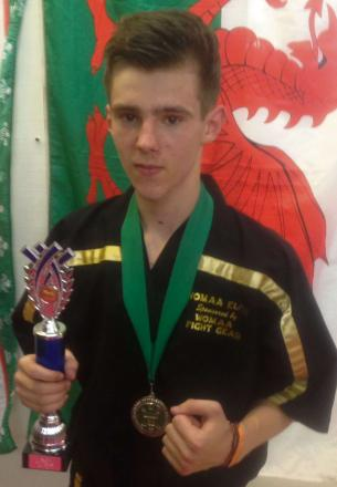 FIGHTER'S MEDAL: Barry teenager Liam Rees, who won a silver medal at the WAKO Welsh martial arts championships.