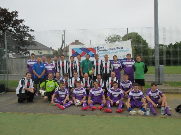 PARTNERSHIP: Barry Communities First and partners in black and white with Barry Llamau in their new purple kit