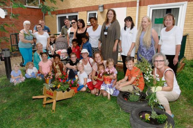 GARDEN DELIGHT: Ty Iolo staff, residents and volunteers mucked in to create a party