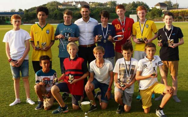 AWARDS: Cardiff City 's Curtis Watkins presented awards to youngsters of the Barry Athletic Football Club U13s side.