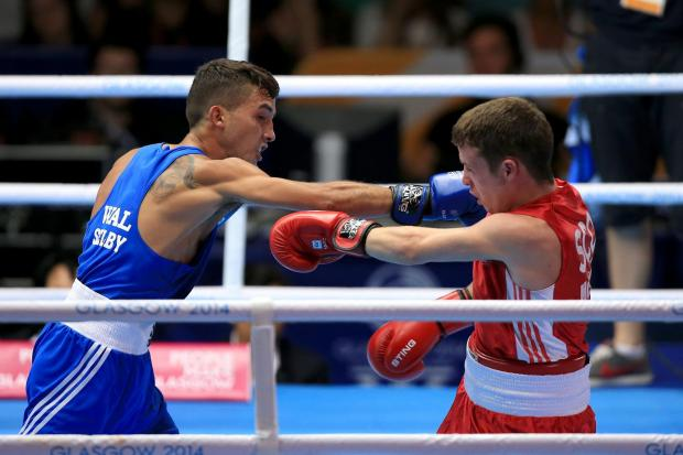 UPSET: Andrew Selby in action against Scotland's Reece McFadden