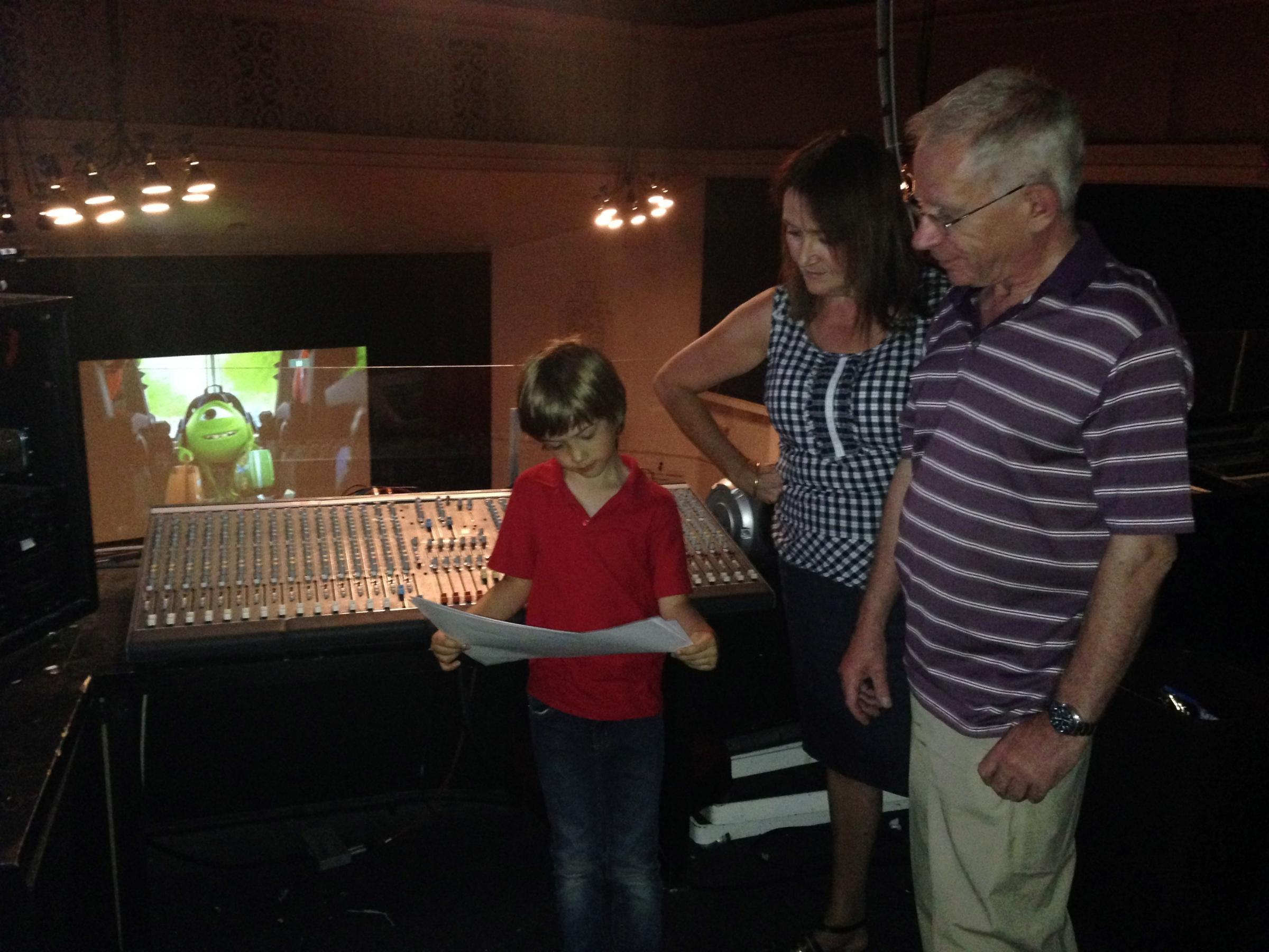 BARRY LISTING: General manager Kate Long and trustee Richard Thomas show the Memo children's holiday film programme to young visitor Morgan Norfolk from Cheltenham
