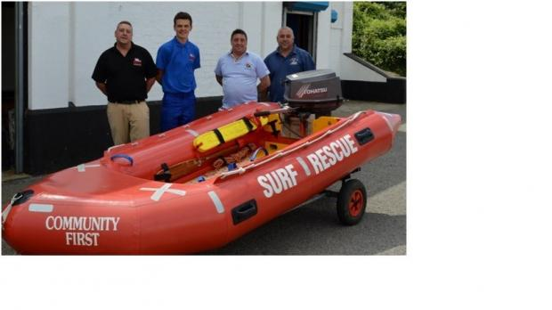 POWER SHOWER: Rhondda Cold Knap Lifeguards with Robert Price Barry staff, Stefan and Theo following the donation