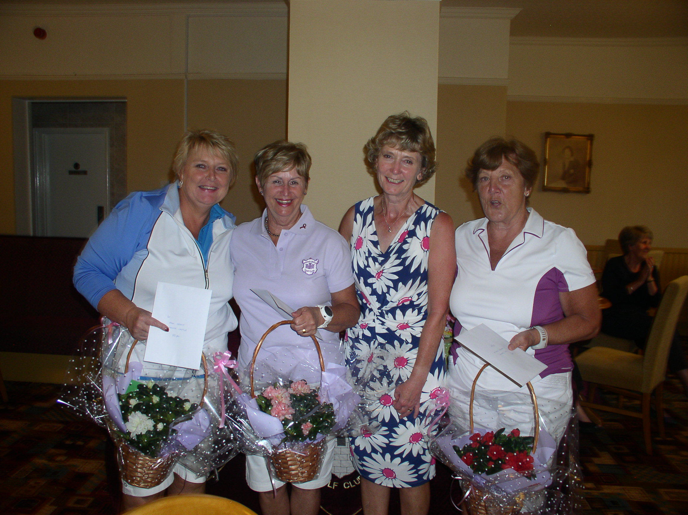 WINNERS: Trish Walker, Lady Captain, presenting the winners, Lynda Campbell, Fran Grant and Tina Church with their prizes and flowers