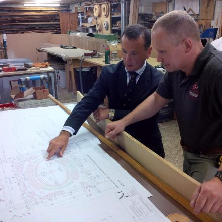 TABLE PLAN: Vale cabinet maker Paul Rathkey (right) shows Vale MP Alun Cairns to the leaders' seats