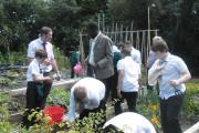 AGRICULTURE: Mr Davies and Mr Ocheing working with students in the school garden