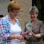 Barry And District News: HONOUR: Jenny Knott being presented with her cup by Vale AM Jane Hutt
