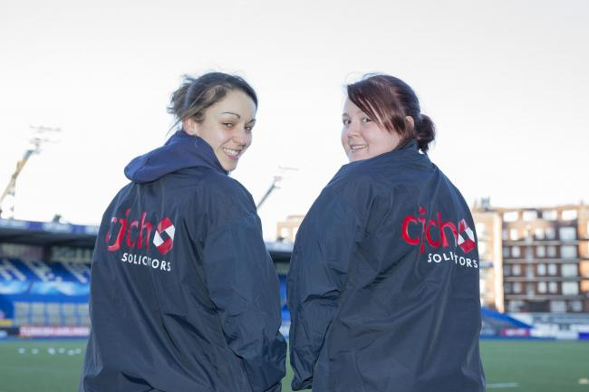 Cardiff Blues women's team vice-captain Rhiannon Parker with teammate Kim Jones in their new CJCH Solicitors sponsored training kit.