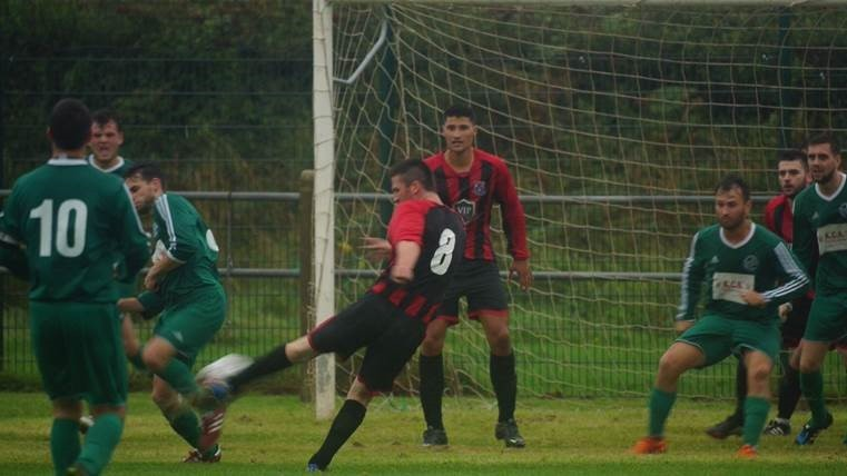 Porthcawl in red and black go for a goal against Cadoxton Barry