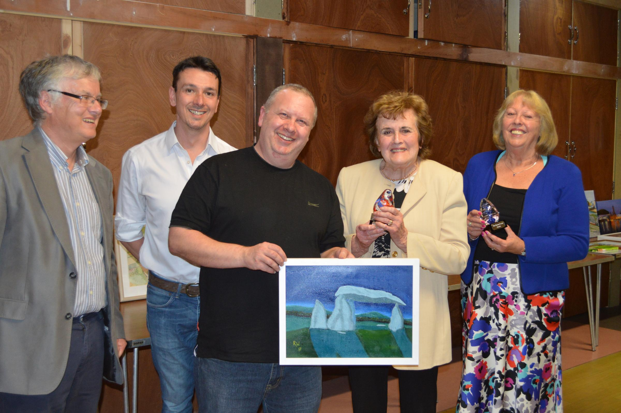 (From left) Nigel Adams chairman, Vaughan Cummings, Robert Williams holding the winning painting, Brenda Young and George Payne's daughter