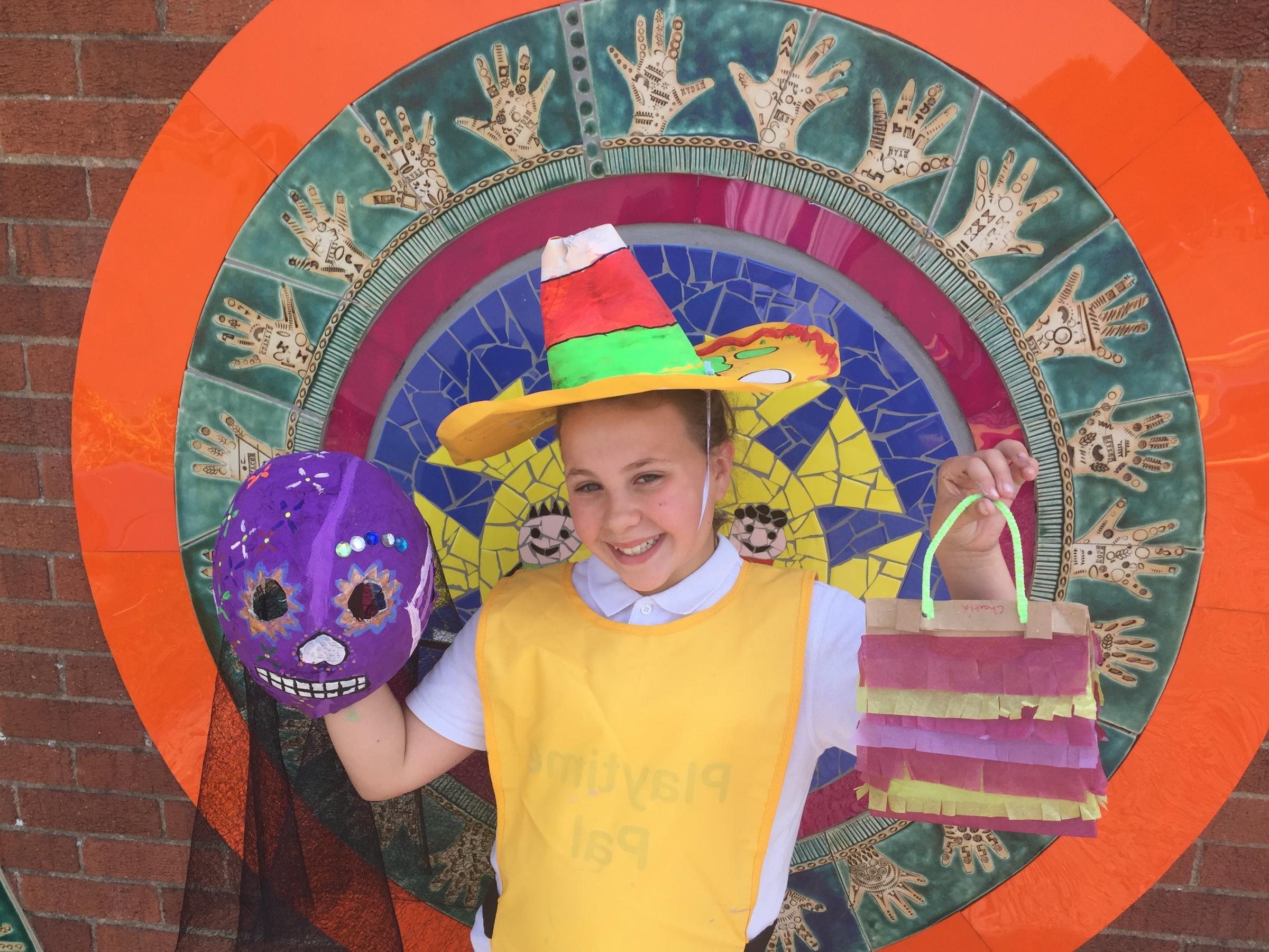 Olivia Hewitson, Aged 11 with her sombrero, mask and piniata