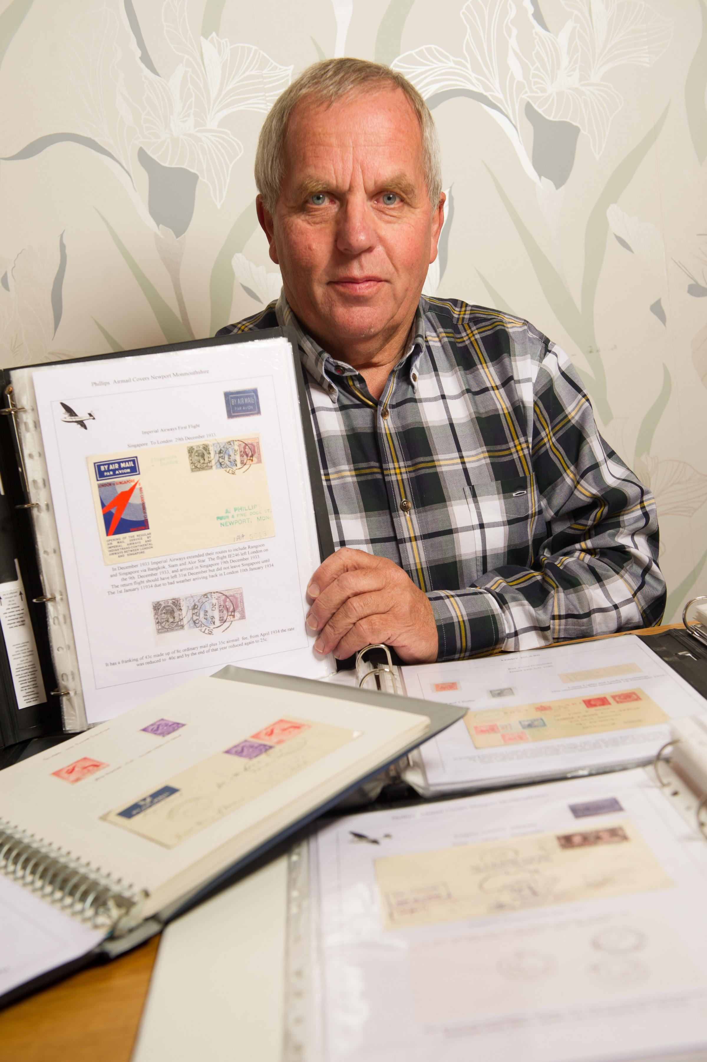 Chairman of Newport Stamp Club Ron Bentley with some of his collection of stamps and airmail covers.