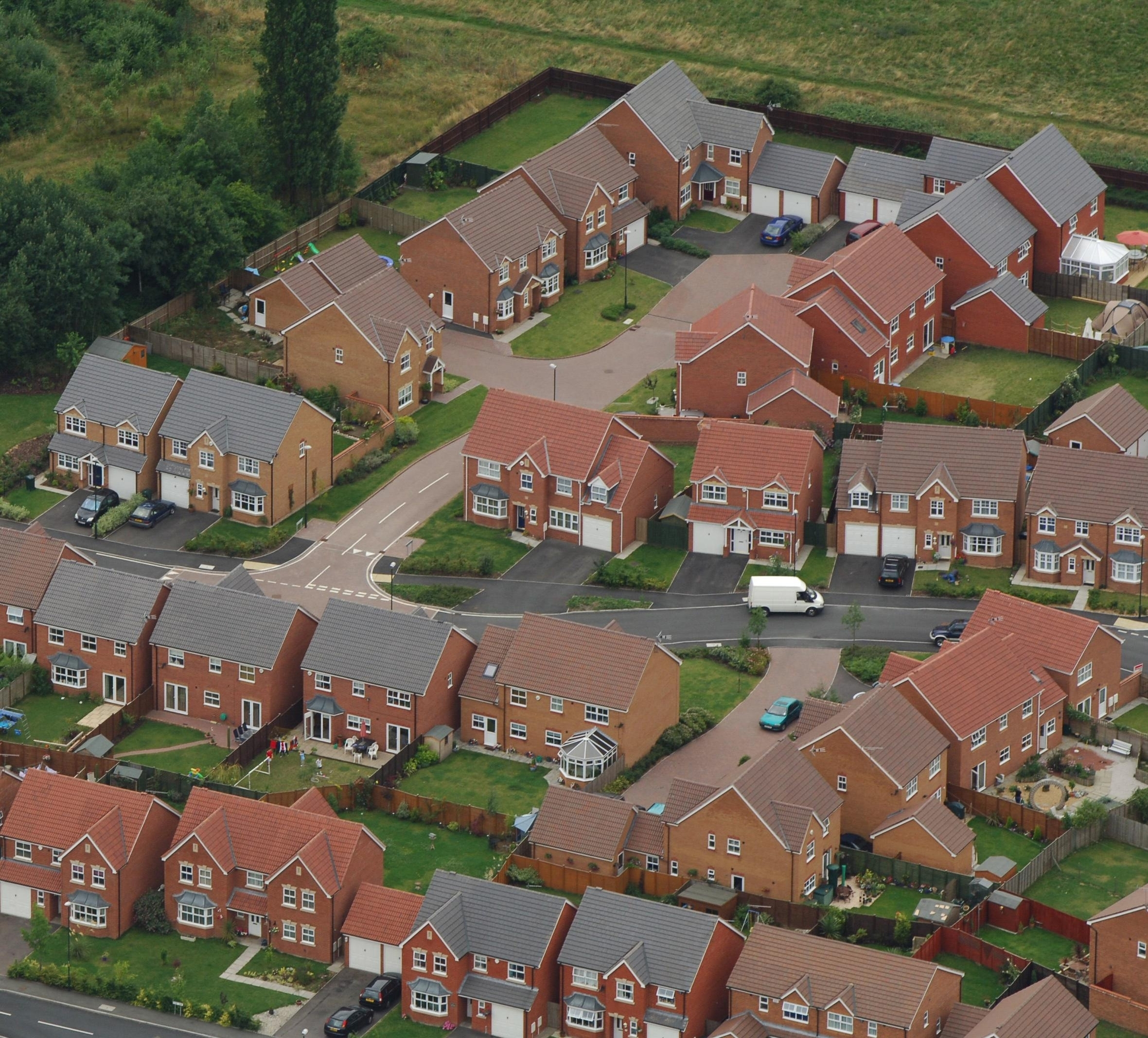 Aerial view of a housing estate near Coventry. House prices edged up 0.2% last month as the average cost of a home remained close to levels seen at the start of the year, the Halifax said Friday August 5, 2005. The bank's monthly update showed the ann