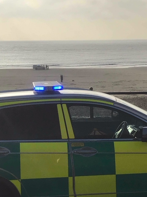 Emergency services attend the scene at Whitmore Bay, Barry Island