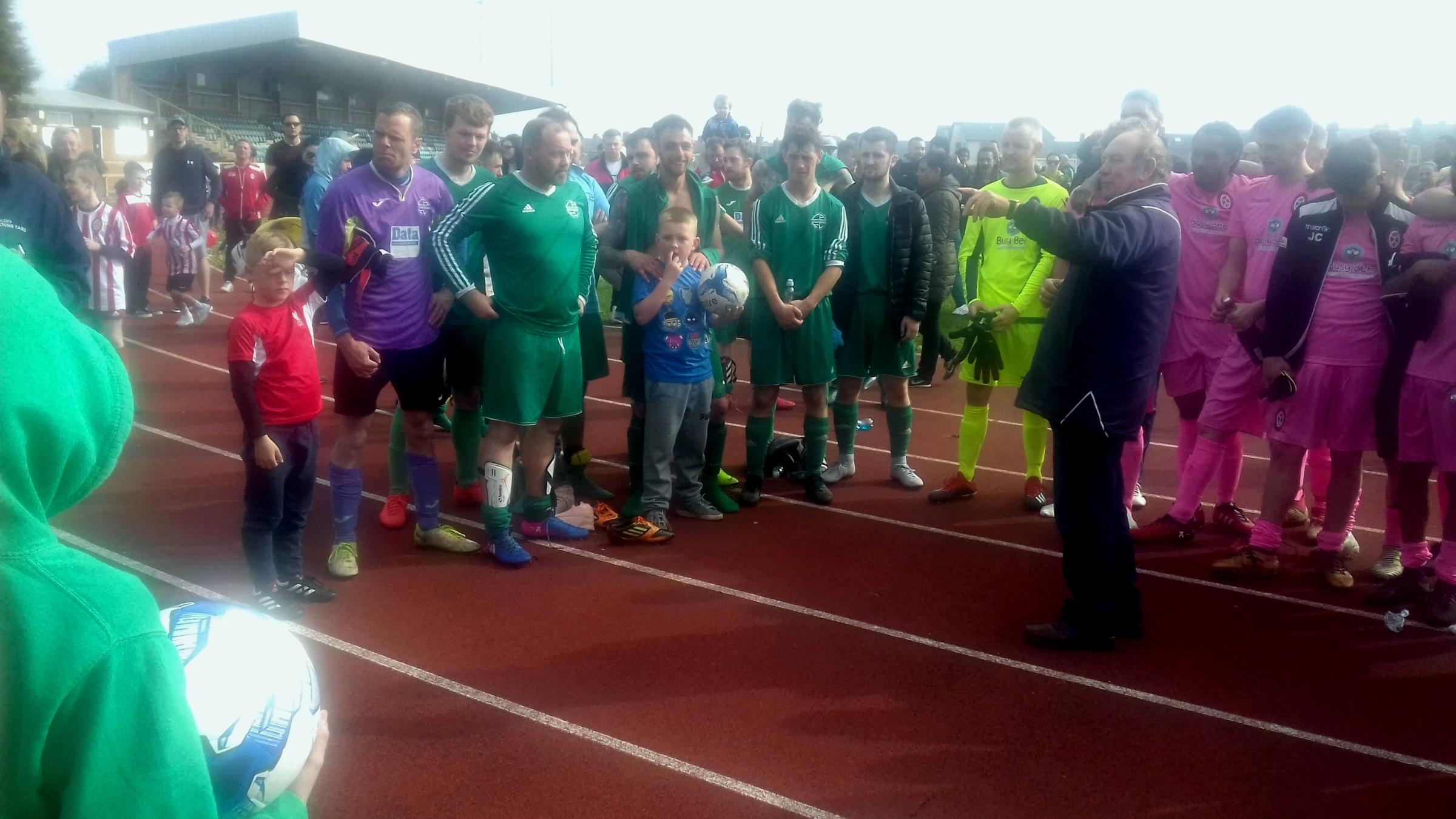Vale of Glamorgan League chairman Tony Williams introduces the presentation team during the excellent demonstration of camaraderie between the two teams that followed the final whistle – Holton Road wearing pink and Cadoxton Barry wearing green