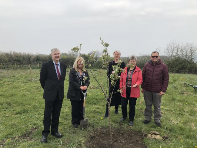 Mark Drakeford, chairwoman of Cardiff and Vale UHB, Maria Battle, Jane Hutt, Stuart Egan, and Eileen Wood, garden designer and staff union founder of Our Orchard